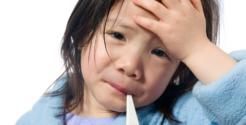 Small child feeling unwell with thermometre in mouth
